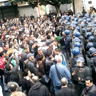 Riot police confront Algerian demonstrators, February 2011. (Photo: Flickr/Magharebia)
