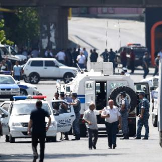 Police blocked a street after group of armed men seized a police station. (Photo: Photolure Agency)
