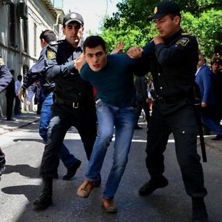 A protester is arrested outside the courtroom after eight youth activists were convicted on May 6. (Photo: Javid Gurbanov/Bizim Yol)