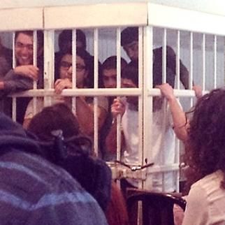 The NIDA defendants in a cage in the courtroom. (Photo courtesy of NIDA)