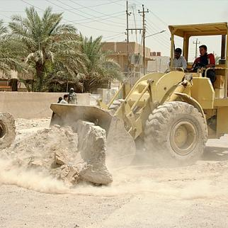 Iraqi construction workers in east Baghdad - but many low-skilled jobs are taken by illegal foreign labourers.
