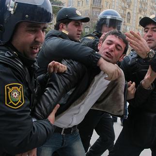 Riot police arrest a protester in Baku, January 2013. (Photo: Samira Ahmedbeyli)