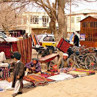 The carpet bazaar at Aq Chah, the centre of a major producing area in northern Afghanistan. (Photo: Mobyhill/Flickr)