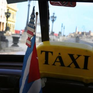 American flag sits above a Cuban flag in a taxi as Cuba prepares for the visit of US president Barack Obama. (Photo: Joe Raedle/Getty Images)