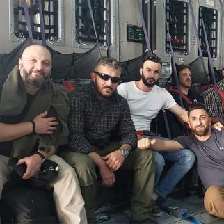 Levan Jangriashvili (in sunglasses), who worked in Afghanistan for many years, on his evacuation flight out of the country after the Taliban takeover