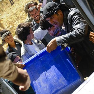Afghans load ballot boxes into a helicopter in Jaghatu, Afghanistan. (Photo: US Air Force Staff Sergeant Joseph Swafford/ISAF)