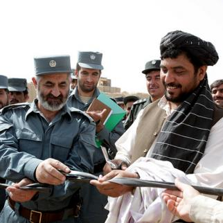 Opening a new police station in Marjah, Helmand province, in September 2010. Some residents say the province is still too dangerous for next year's presidential election to go ahead. (Photo: Lance Cpl. Paige J. Bray/US Marines/Isafmedia/Flickr)