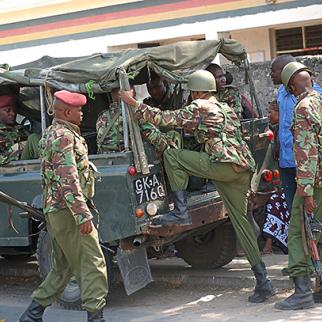 Officers depart on an operation from outside a Mombasa police station. (Photo: Joseph Akwiri)