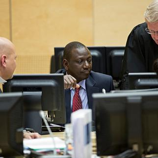 Ruto consults his lawyers during an ICC status conference in The Hague. (Photo: ICC-CPI/Flickr)
