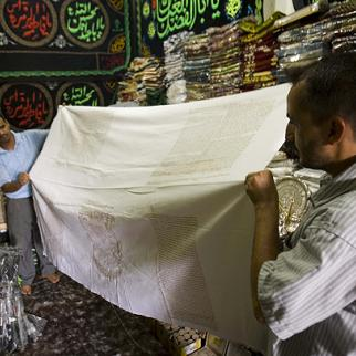 Shrouds from the holy city of Karbala are prized by Shia Muslims. (Photo: Metrography)