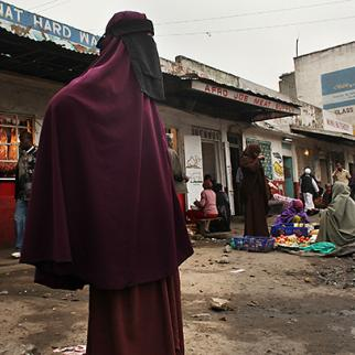 A woman stands on a street corner in Eastleigh, a predominantly Muslim Somali neighbourhood in Nairobi. (Photo: Spencer Platt/Getty Images)