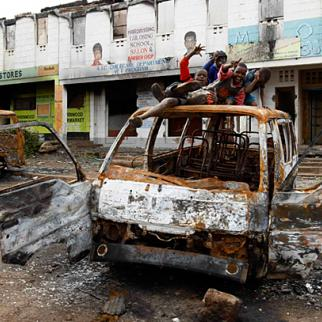 Children play on top of a vehicle destroyed during post-election violence in Kibera, Nairobi. (Photo: The Star/Kenya)