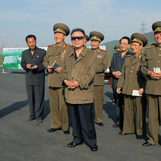 President Kim Jong-Il with members of the North Korean military, accused of launching attacks on the south last year. (Photo: North Korea's official website)
