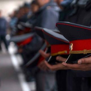 Photo: Kyrgyz police uniform caps. (Photo: Tabyldy Kadyrbekov, Sputnik.kg news agency)