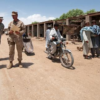 American troops inspect a Marja bazaar. (Photo: D. Myles Cullen, Courtesy of U.S. Army)