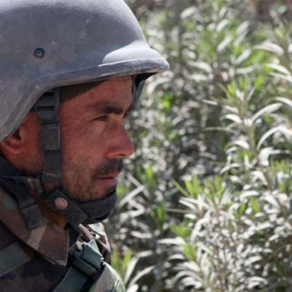 An Afghan National Army soldier on patrol in a residential area of Marja. (Photo: Regimental Combat Team-7, 1st Marine Division Public Affairs/Staff Sgt. Luis Agostini)