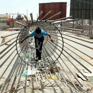 A boy plays at a construction site in the Iraqi city of Najaf. (Photo: Alaa al-Marjani)