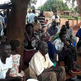 A community debate in Nwoya district allowed local residents to put concerns to local government representatives. (Photo: IWPR)