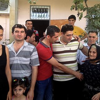 Safarov (right, in striped t-shirt) with his relatives and a member of parliament Ganira Pashayeva (left). (Photo: Vdadi Mammadov)