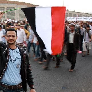 Anti-regime protestors march in Sanaa. (Photo: Kate Dixon/Flickr)