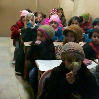 Children wait to eat after school is over. (Photo: Hiba al-Rahman)
