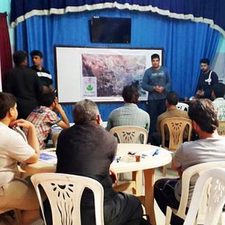 A meeting about the progress of Kfar Nabel's census project. (Photo: Mostafa al-Jalal)