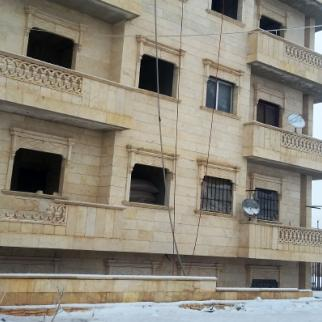 Kfar Nabel's stonemasons invest in building residential buildings. (Photo: Hadia al-Mansour)