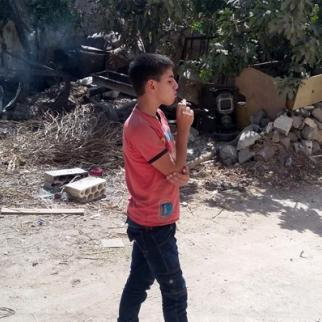 Syrian boy smoking. (Photo: Syria Stories)
