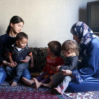 A displaced family from Kobani settle in Aleppo's Sheikh Maqsud neighbourhood. (Photo: Baraa al-Halabi)