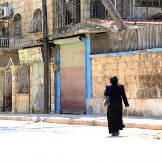 A woman in Aleppo's Seif al-Dawla neighbourhood. (Photo: Hussam Kuwaifatiyeh)