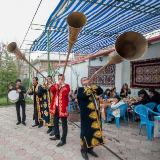 Karnay musicians perform in Dushanbe on their long trumpets, which can be up to two metres long. (Photo: Bahriddin Isamutdinov)