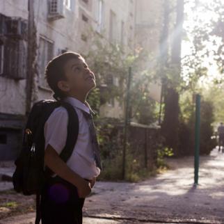 Daniil prepares to go to school for the first time. (Photo: Roman Buryak)