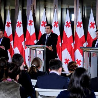 President Mikheil Saakashvili (centre) after meeting parliamentary speaker David Usupashvili on February 8, 2013. David Bakradze (right) heads the parliamentary group of Saakashvili's UNM party. (Photo: Georgian president's website)