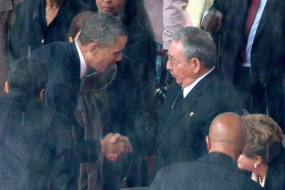 U.S. President Barack Obama shakes hands with Cuban President Raul Castro during the official memorial service for former South African President Nelson Mandela on 10 Dec 2013, Johannesburg, South Africa.