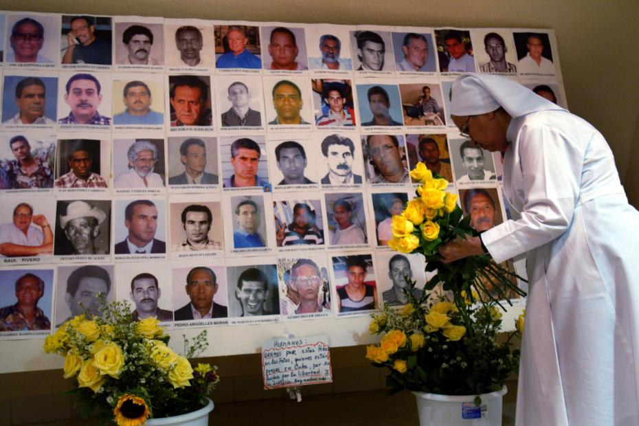 Photographs of arrested Cuban dissidents. The number of all political prisoners in Cuba, in 2004, has been estimated at more than 300 by human rights activists on the island.