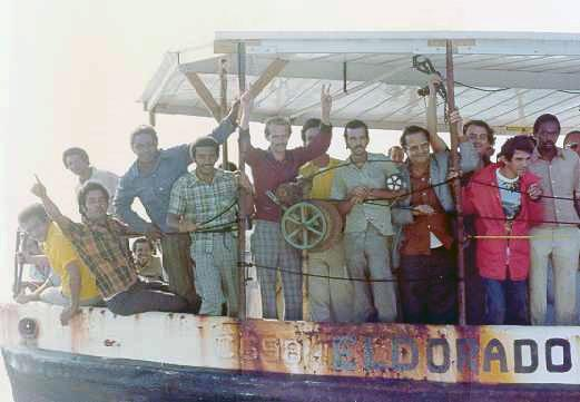 Cuban refugees arriving in crowded boats during the Mariel boatlift crisis.